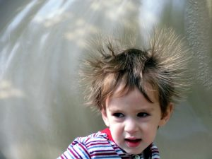 Photo of a boy with his hair sticking up from static shock