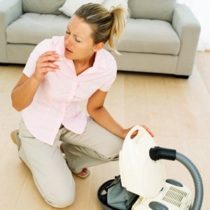 Women Sneezing When Vacuuming